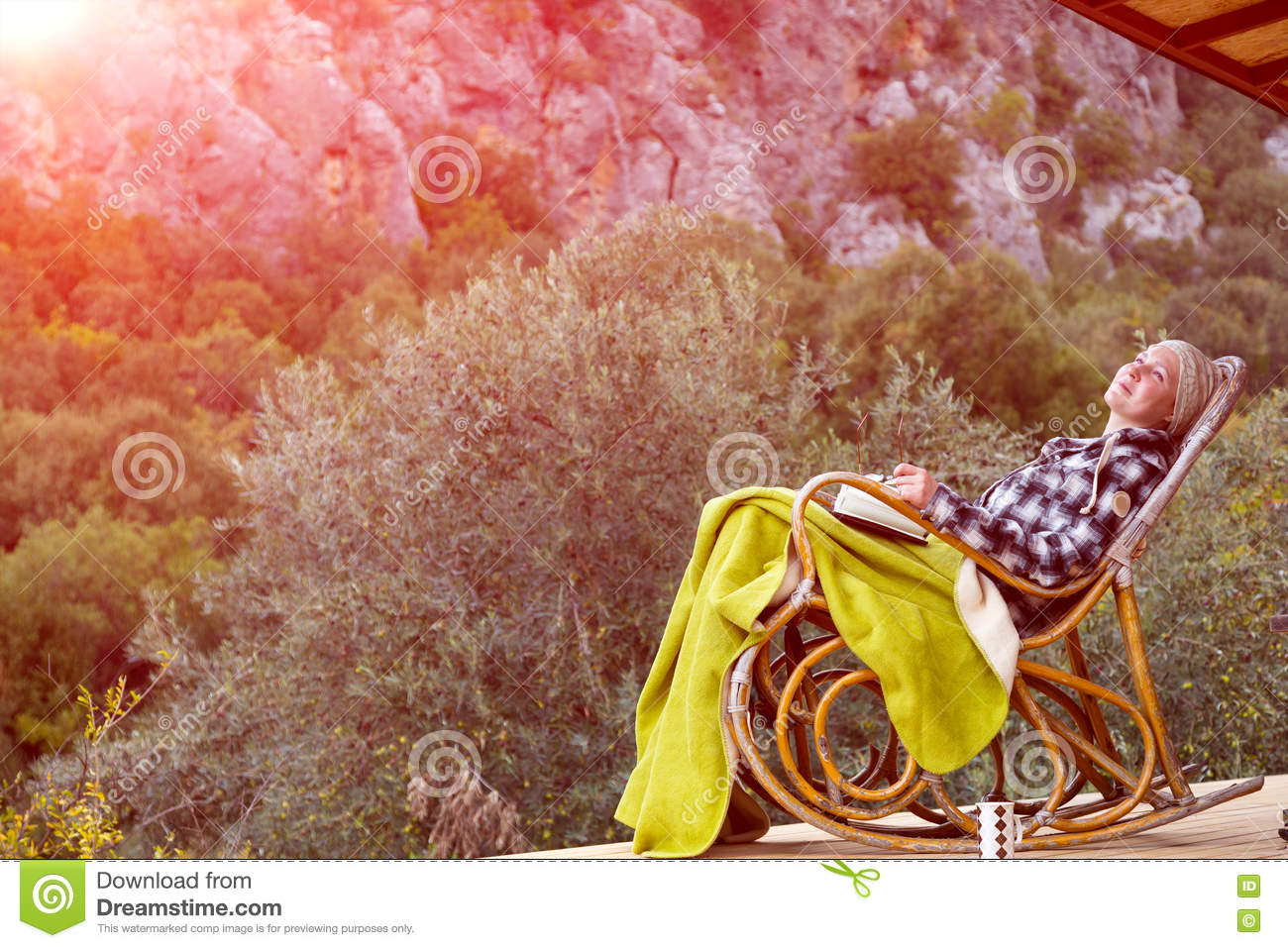 Strange Woman Relaxing On Vintage Rocking Chair At Wooden Balcony Ibusinesslaw Wood Chair Design Ideas Ibusinesslaworg