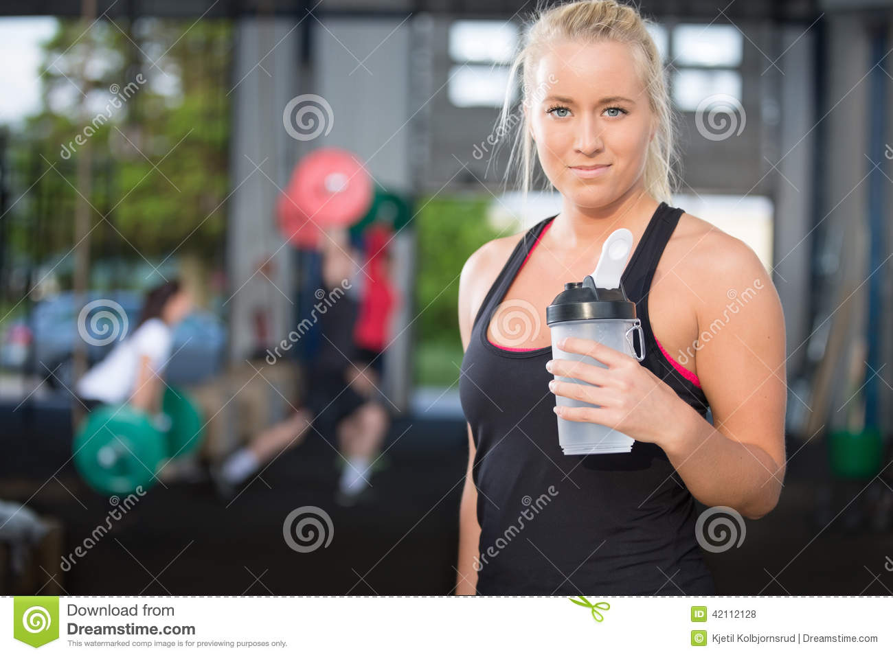 Woman rest and drinking water at fitness gym stock photo image woman rest and drinking water at fitness gym sciox Gallery