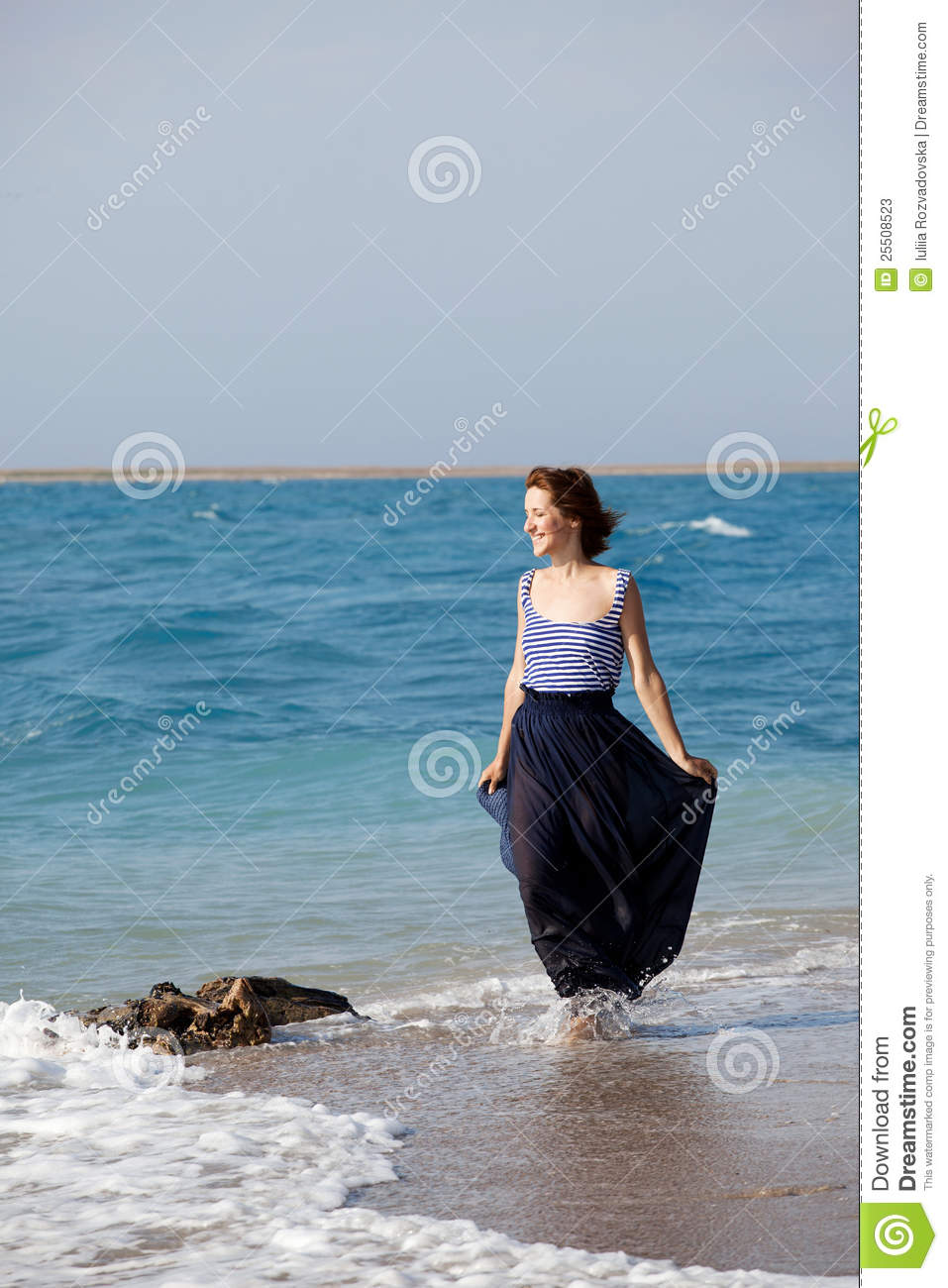 812dc227b6b Portrait of young beautiful tanned woman resting on the beach in summer day