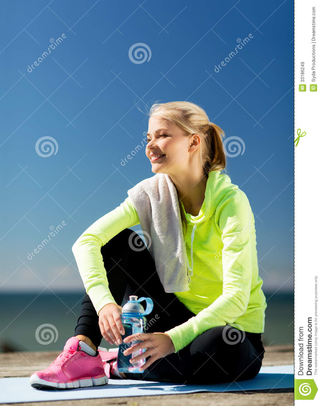 Sport and lifestyle concept woman resting after doing sports