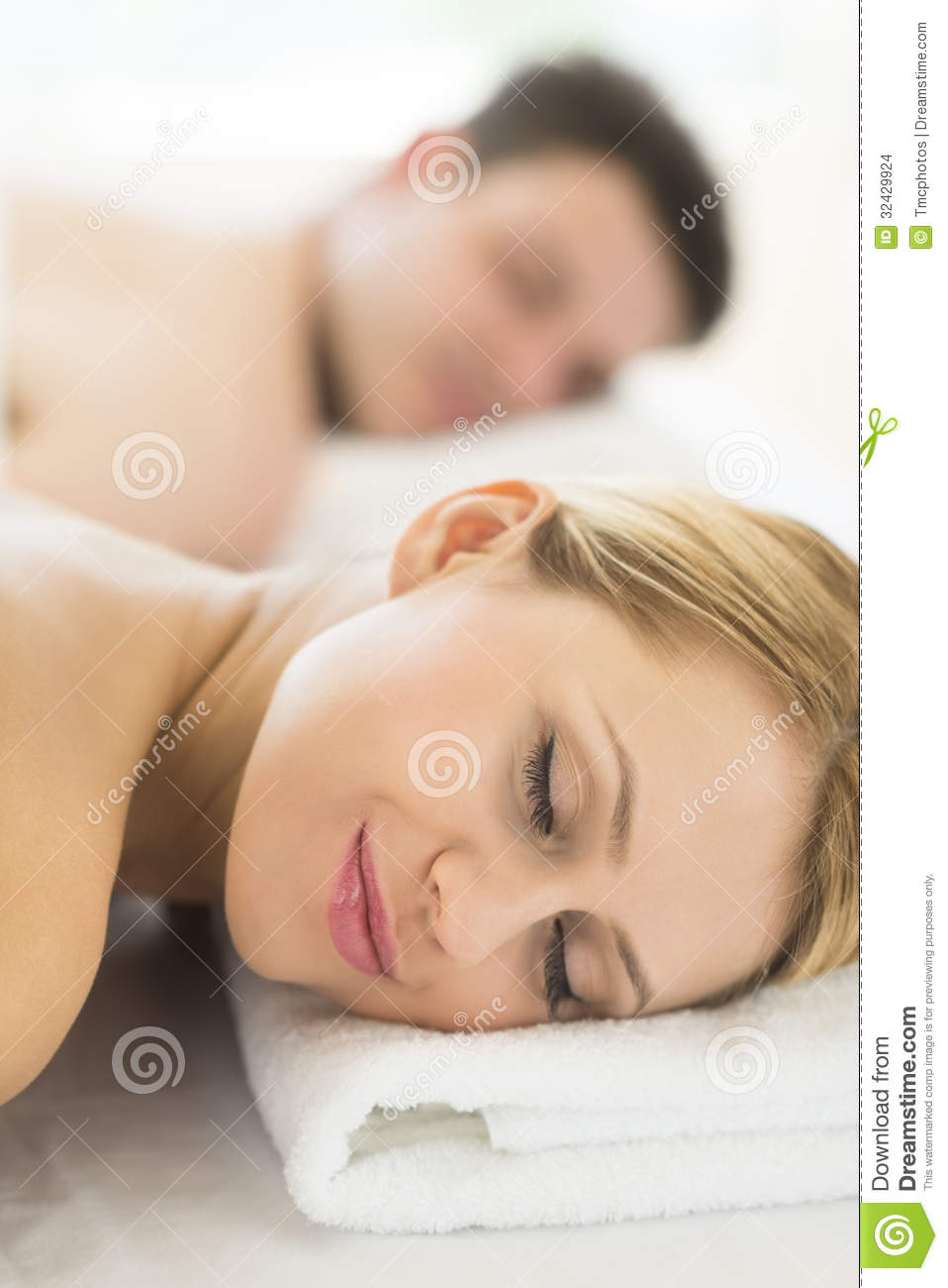 woman resting on massage table at spa stock images