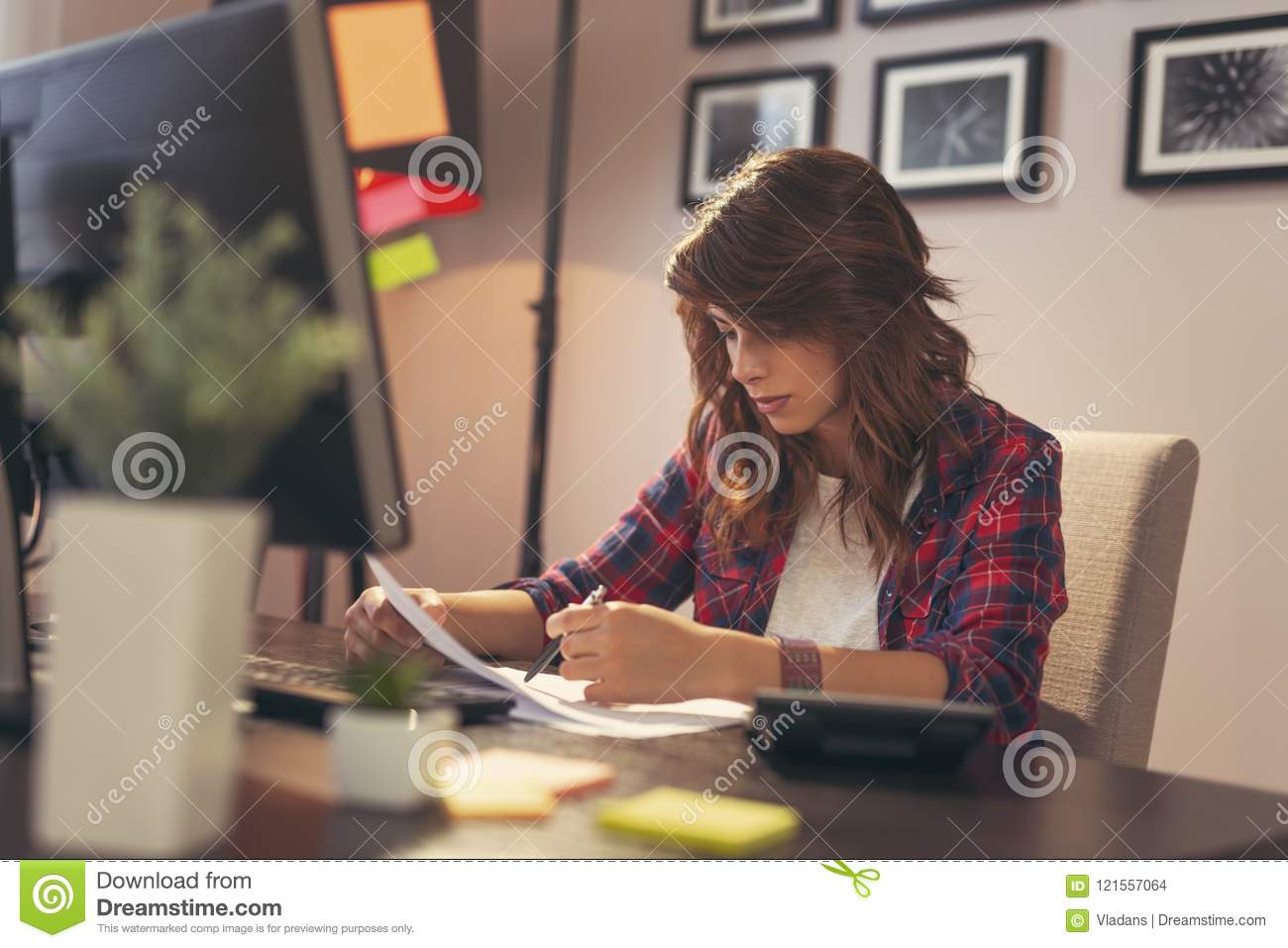 Woman reviewing documents in a home office