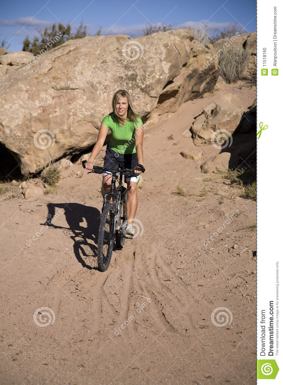 Woman riding bike in sand