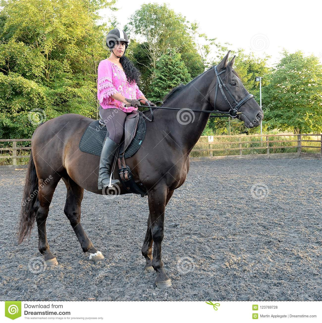 Woman riding brown horse