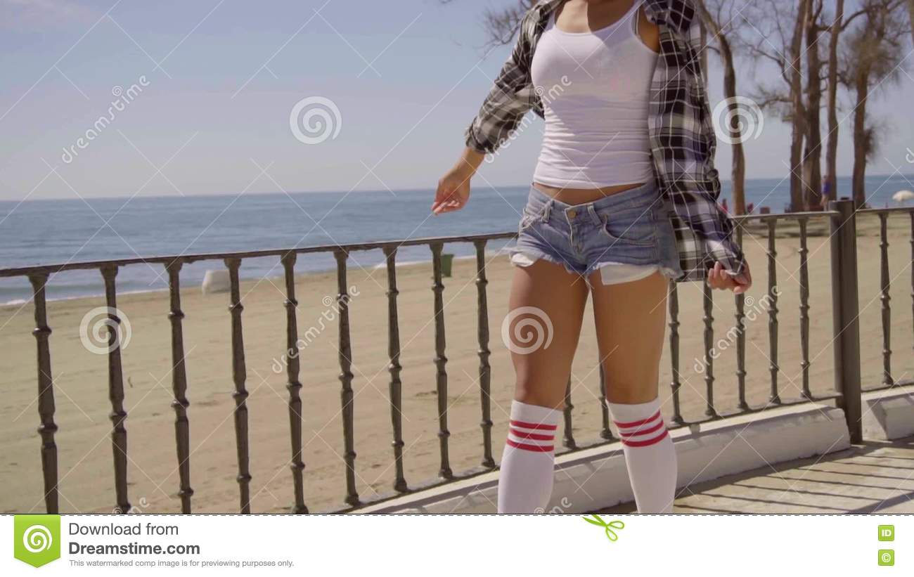 133130ed3a7 Woman Riding On Vintage Roller Skates. Stock Footage - Video of promenade