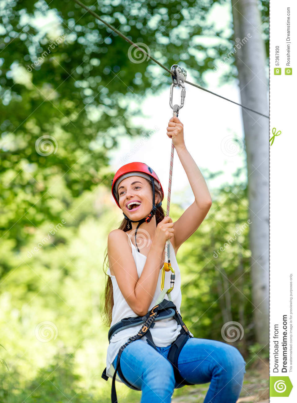 woman riding on a zip line royalty