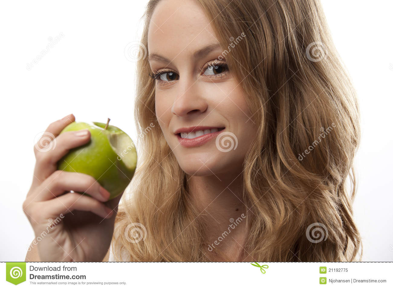 Woman with ripe green apple
