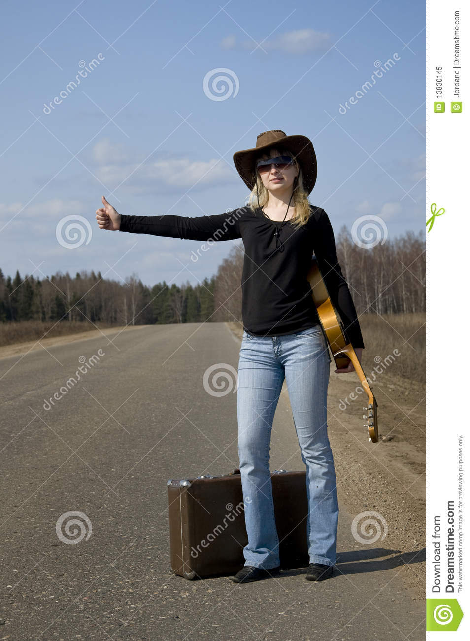 Woman on the road in auto-stop