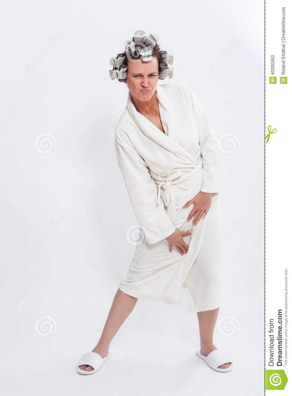 Humorous Full Length Portrait of Woman with Hair in Rollers Wearing White  Bath Robe and Slippers Standing with Pouted Lips and Provocative Facial  Expression ... bd6842951