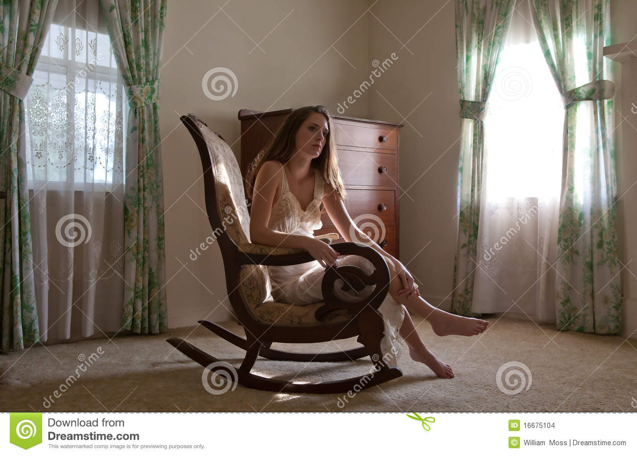 nude girl in rocking chair