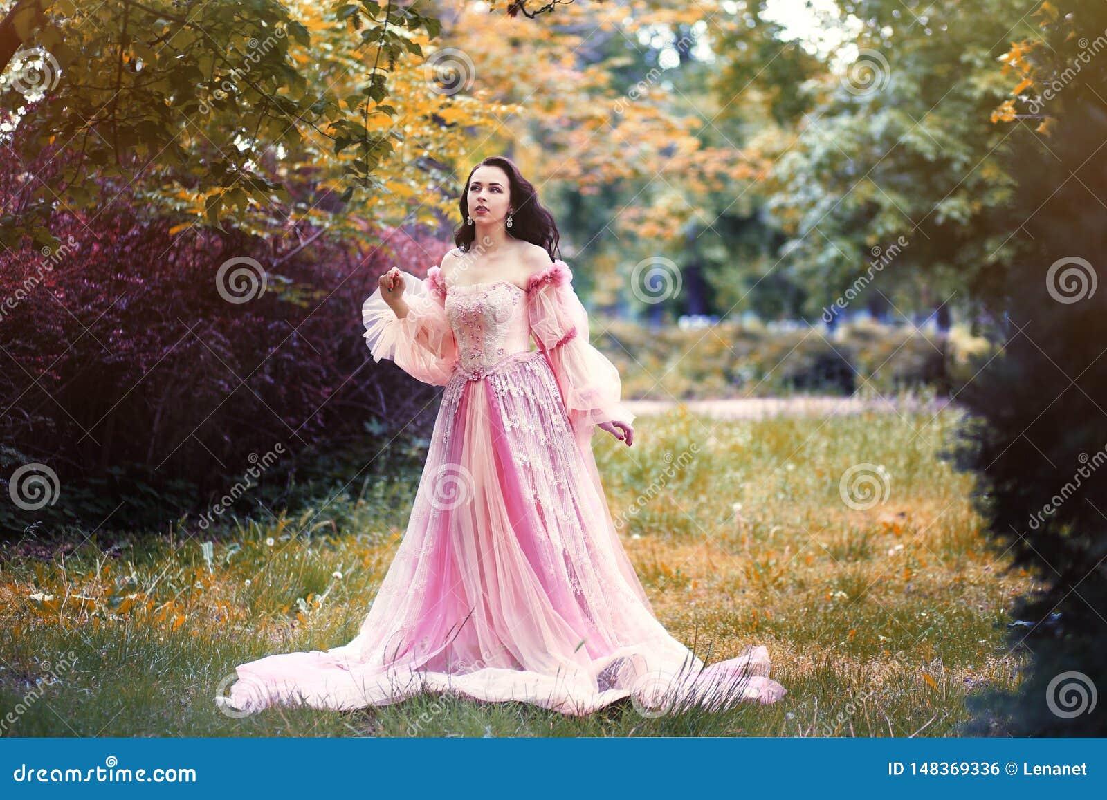 Woman in romantic pink dress