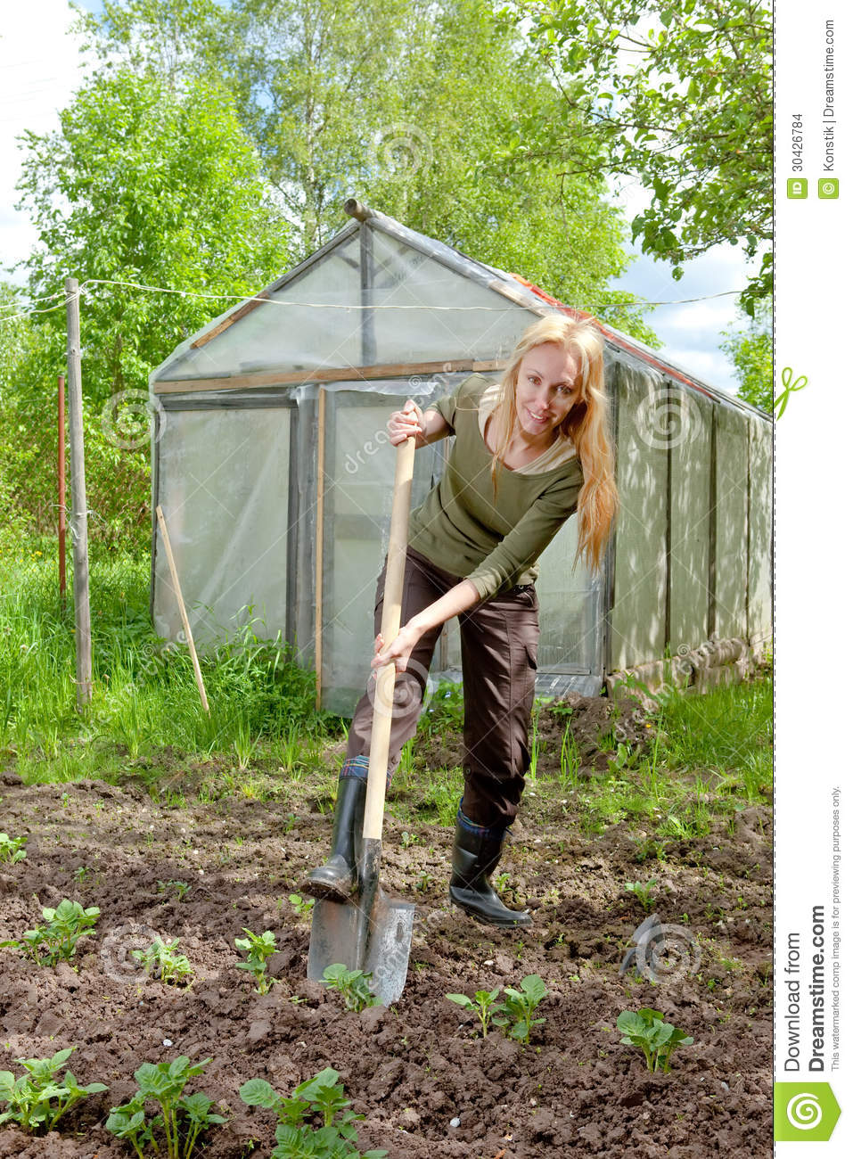 The Woman In Rubber Boots With A Shovel Stock Images - Image: 30426784
