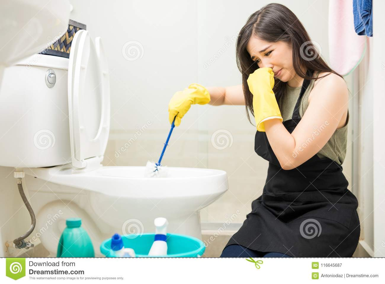 Woman With Rubber Glove Is Cleaning Toilet Bowl Using ...