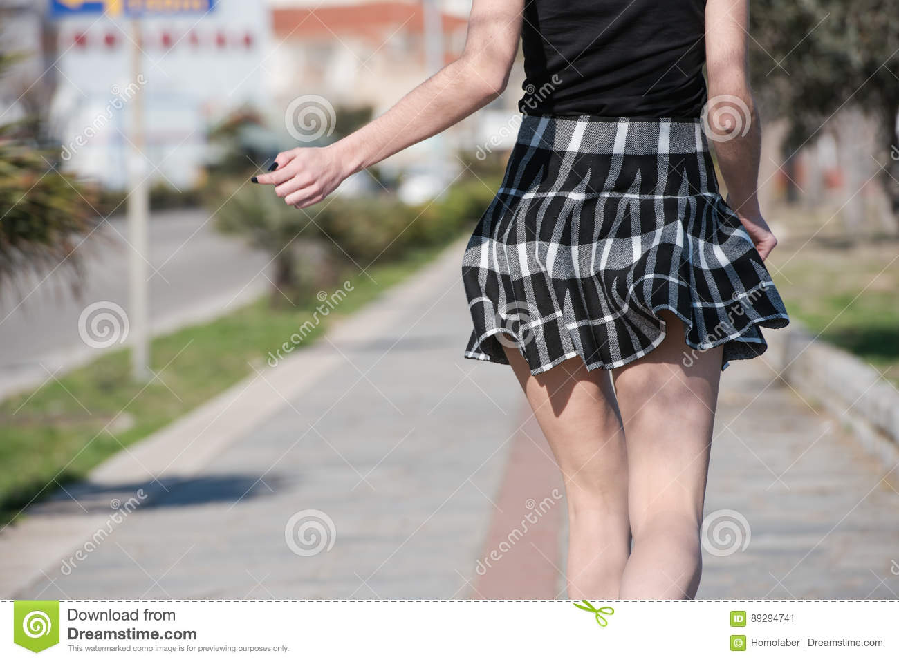 Woman Run Away At Sidewalk With Her Mini Skirt Jump Up And ...