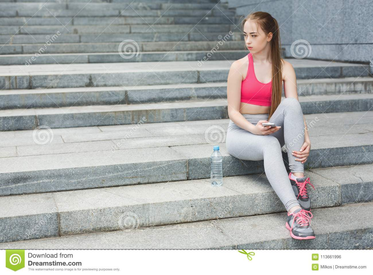 Woman runner is having break