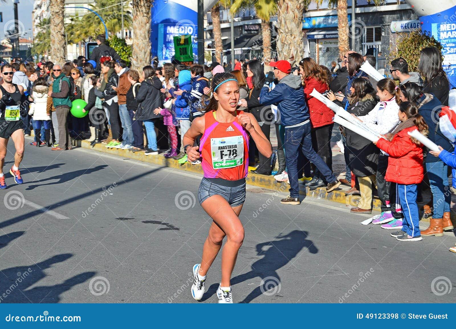 Woman Runner In Marathon Race