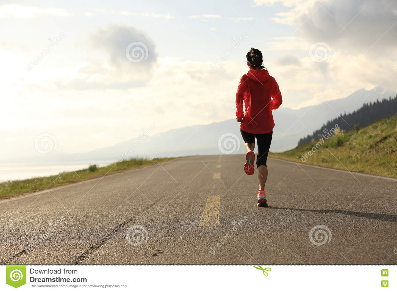 Woman runner running on road