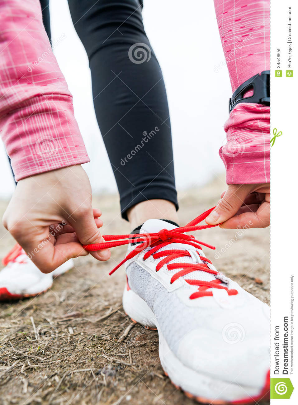 Holding Running Shoes With Mountains