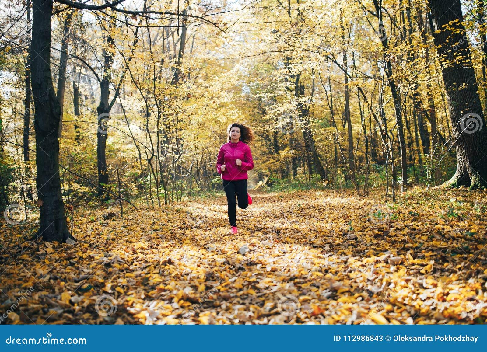 Woman running during morning park
