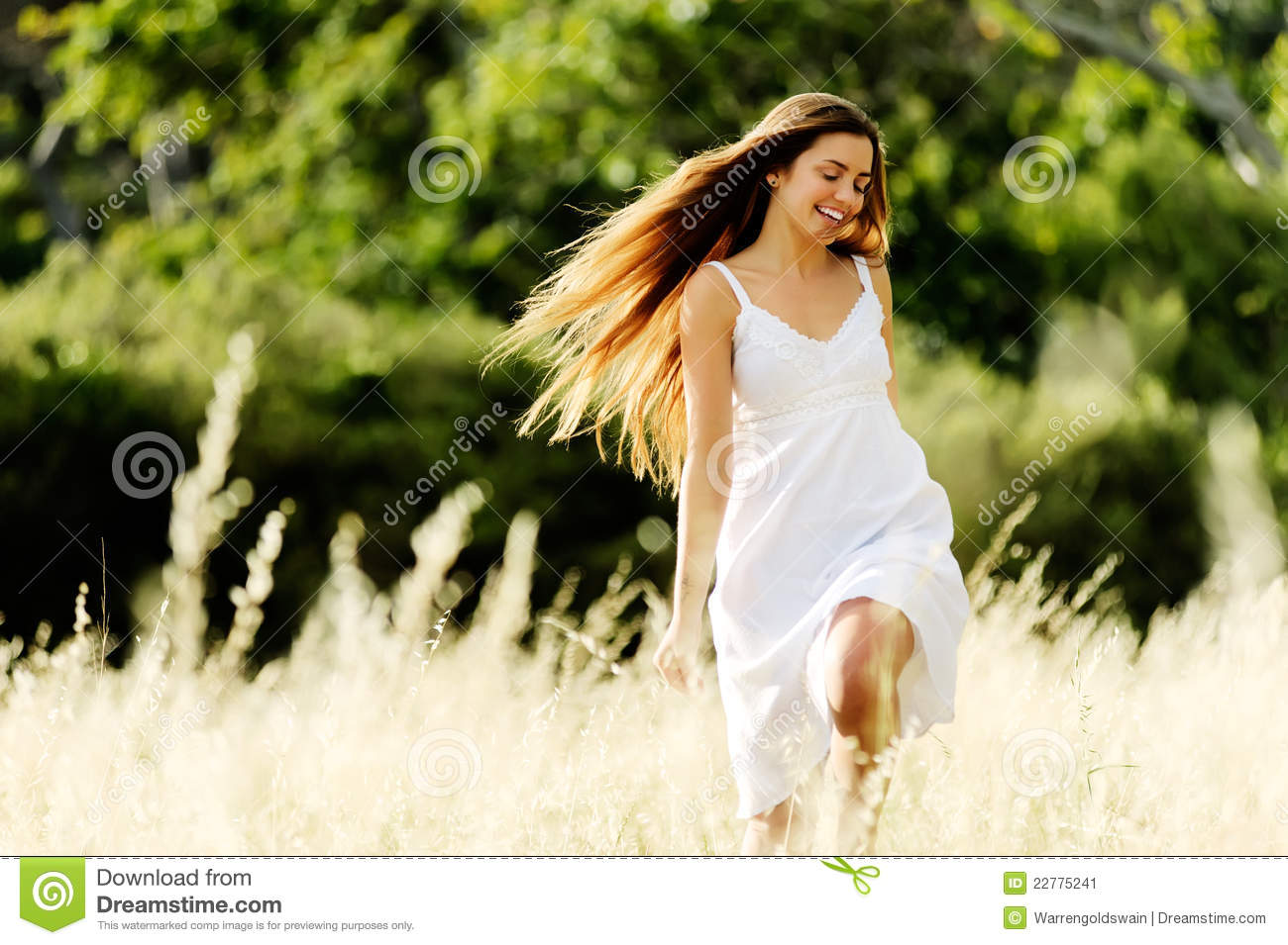 Woman running outdoors in a field