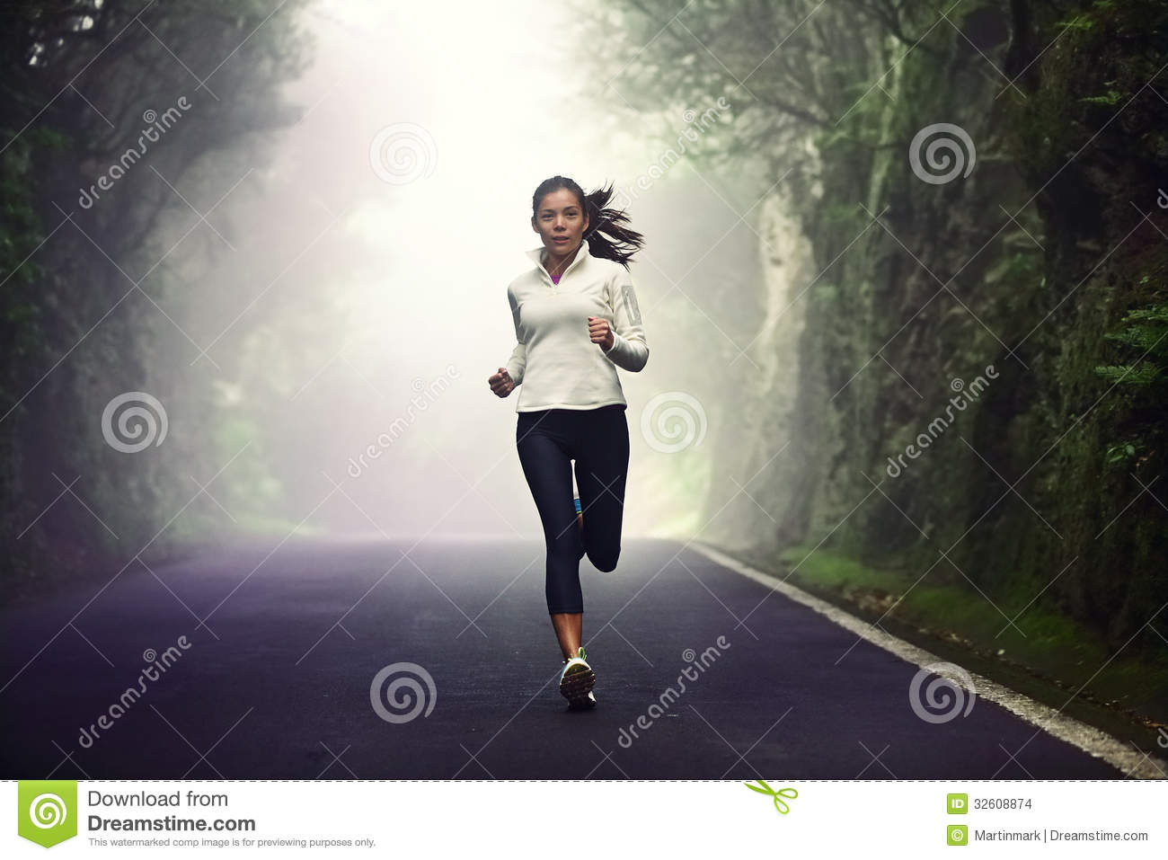 Woman Jogging On Gravel Mountain Road Stock Photo | Getty Images