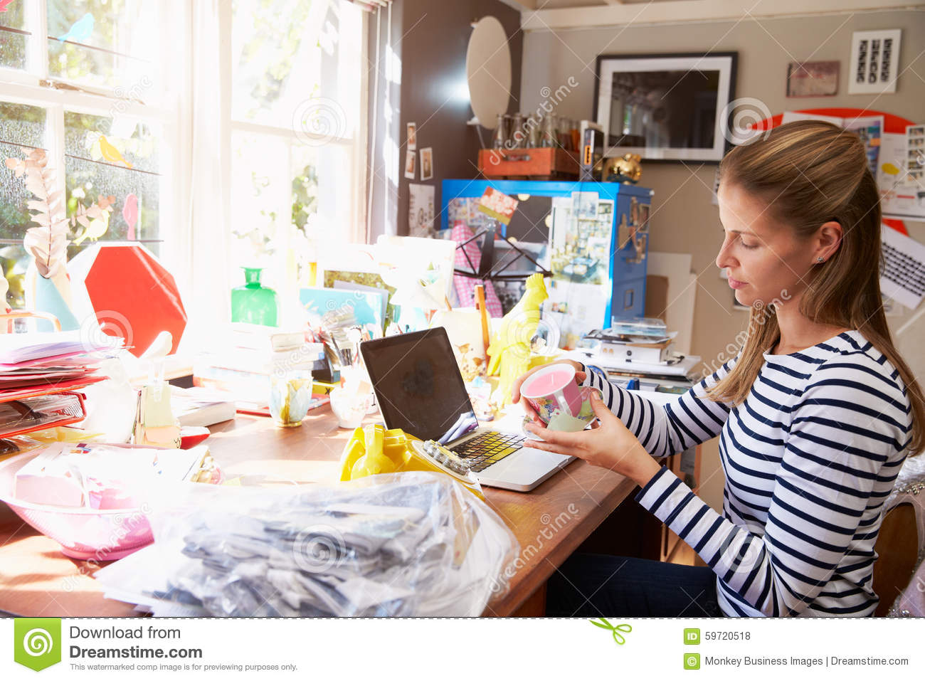 woman running small business from home office stock photo image of