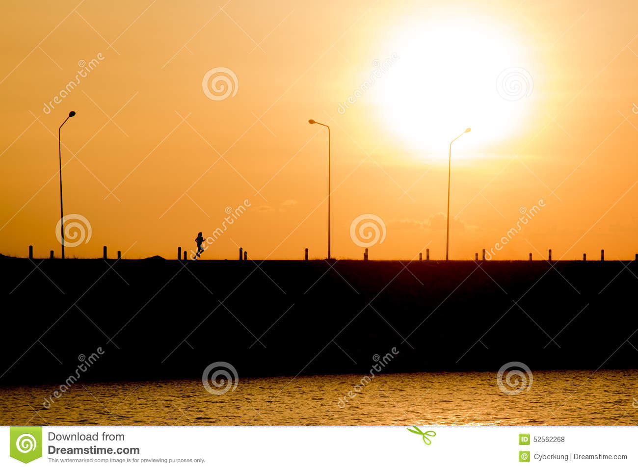 Woman is running in sunset (silhouette)