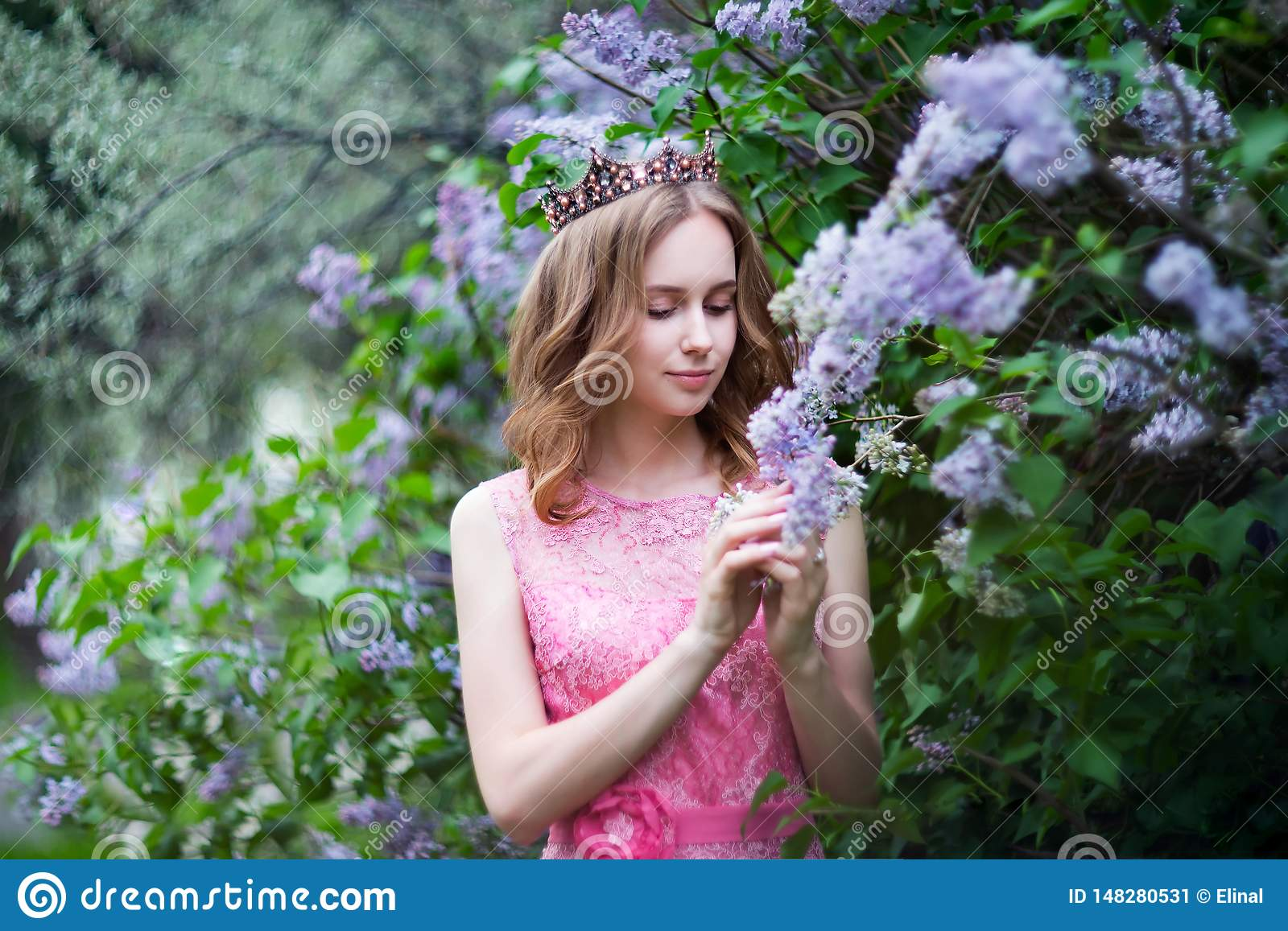 Woman, russian model in spring blossom lilac park