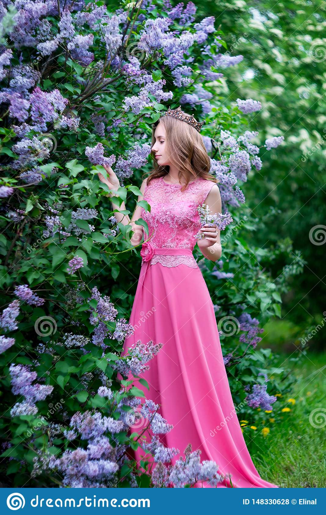 Woman, russian model in bloom spring lilac park