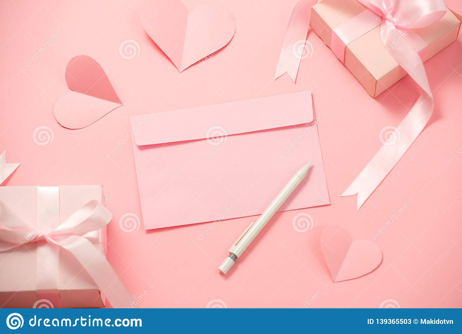 Woman`s Day; romantic template; mock up with heart paper; pink box gift; bow ribbon and envelope in pink background