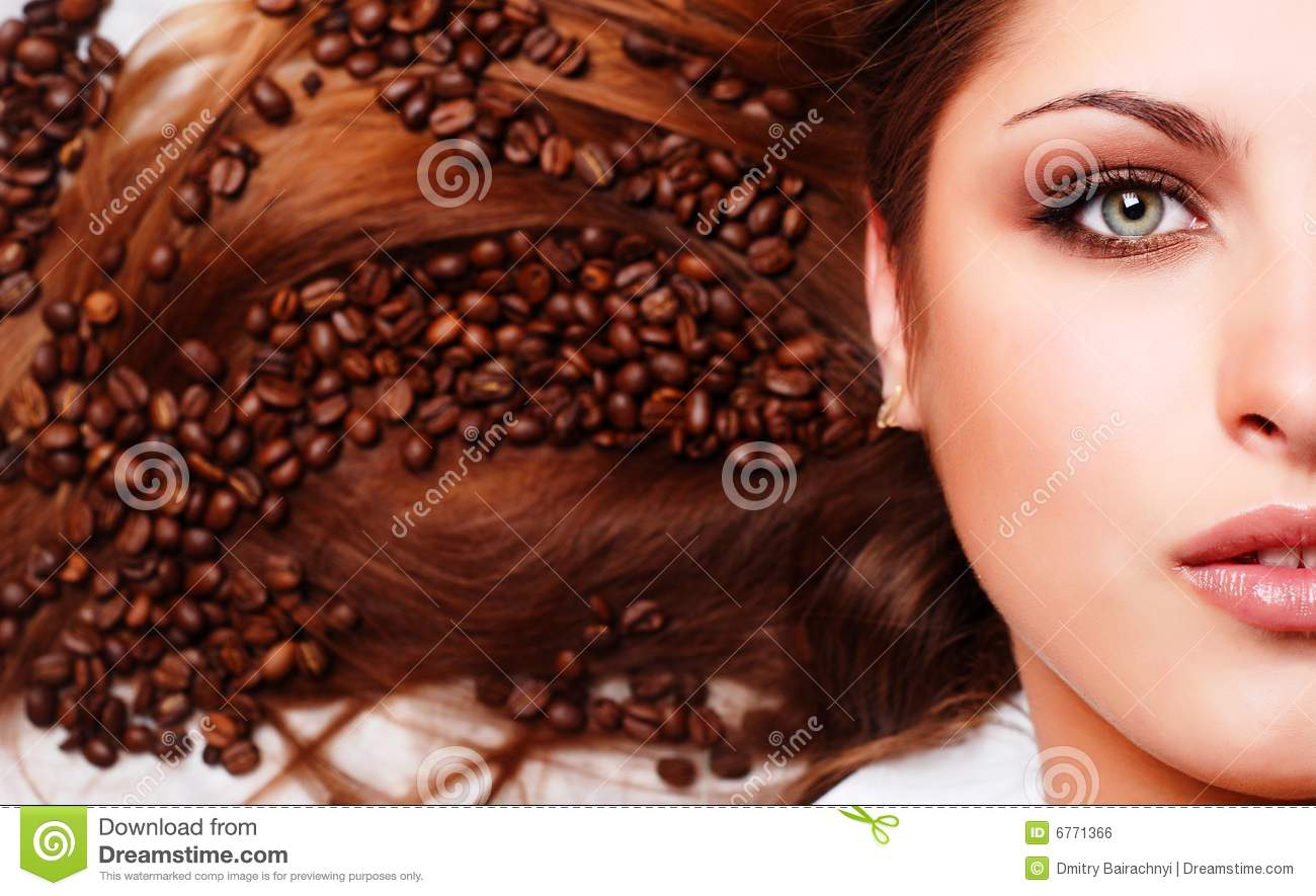 Woman s face with coffee beans