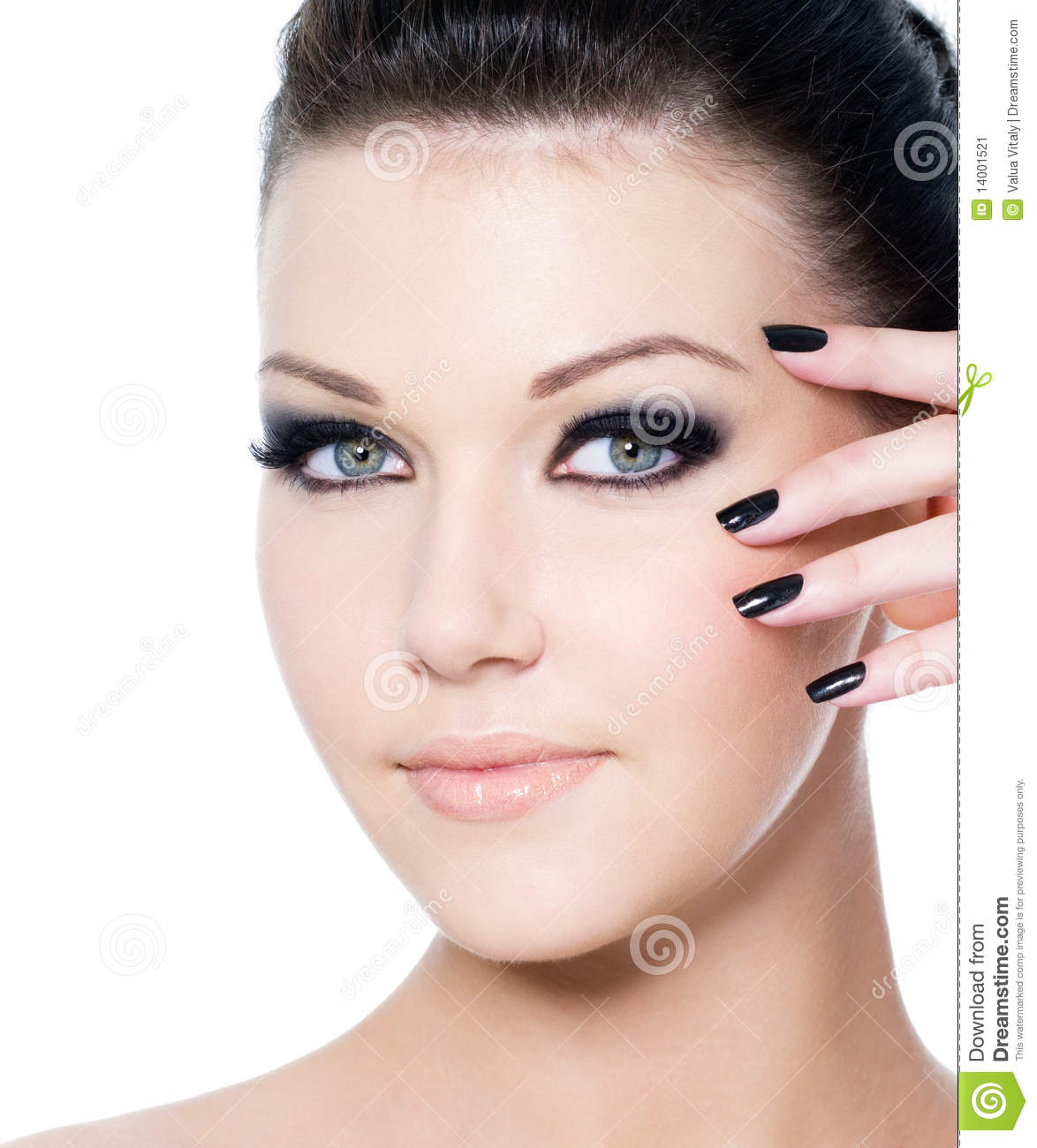 Portrait of a young beautiful woman with fashion black make-up and ...