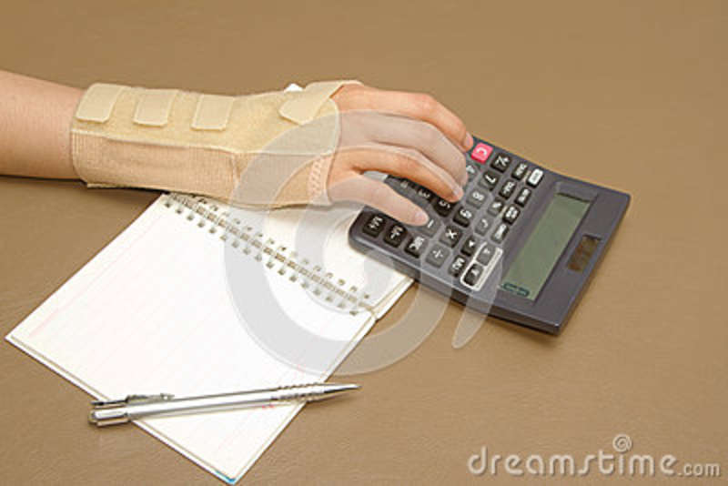 Woman s hand with carpal tunnel syndrome doing calculations