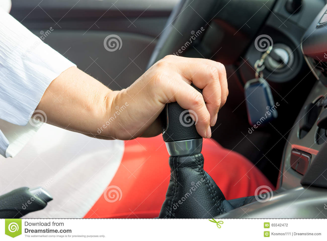 Woman s hand holding a the shift lever in a car