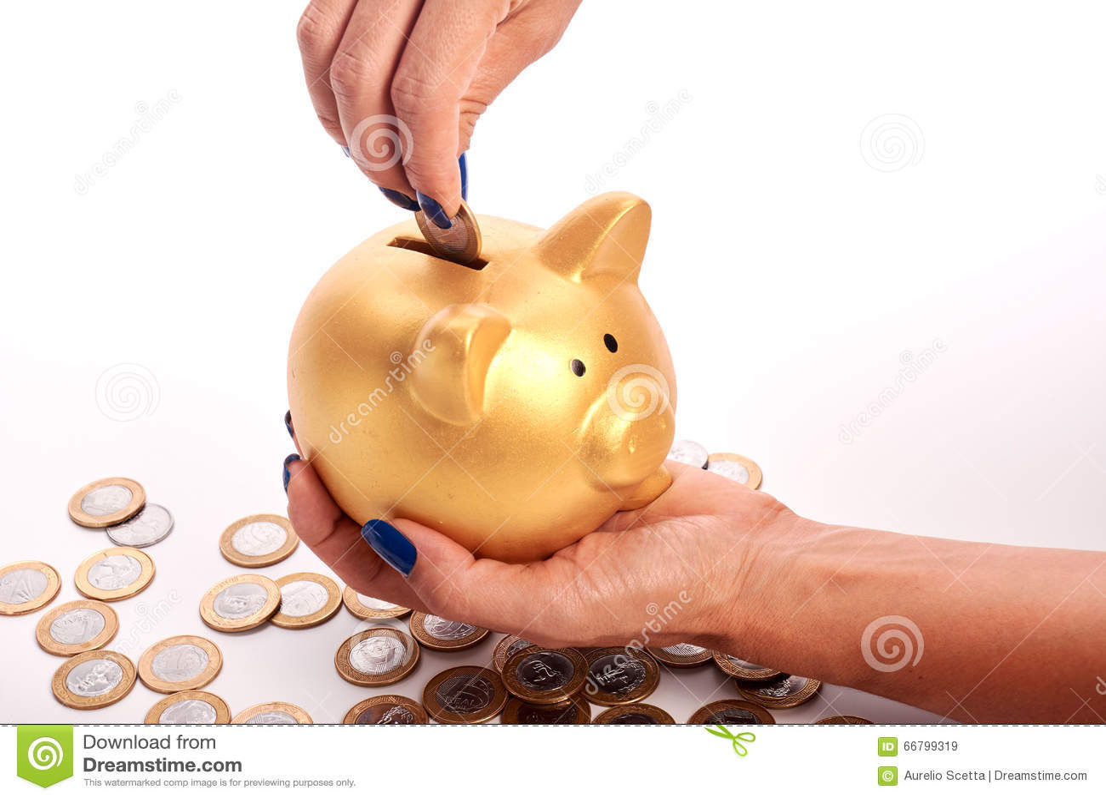 woman u0026 39 s hand putting coins brazilian money into piggy bank