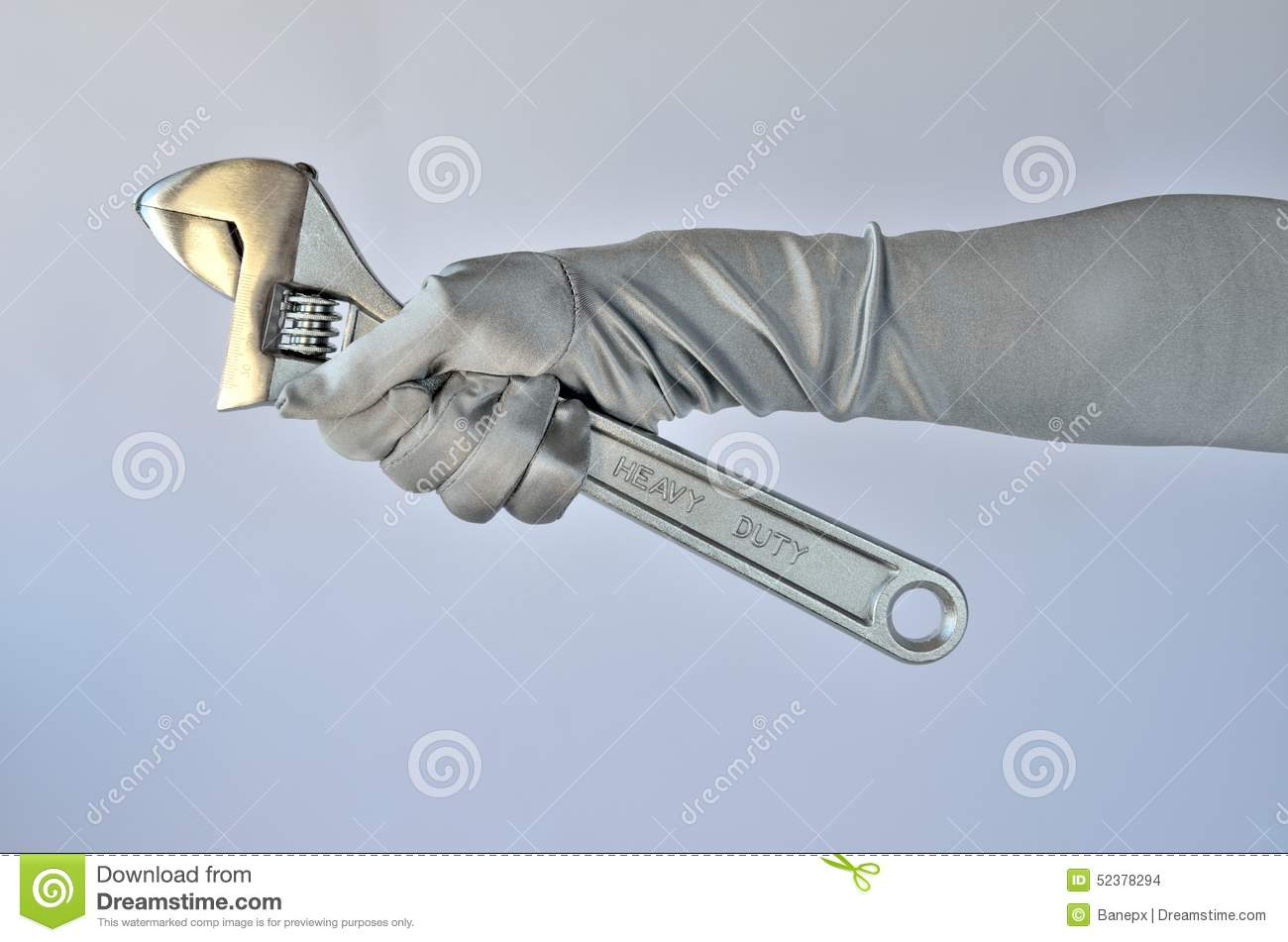 Woman s hand and wrench