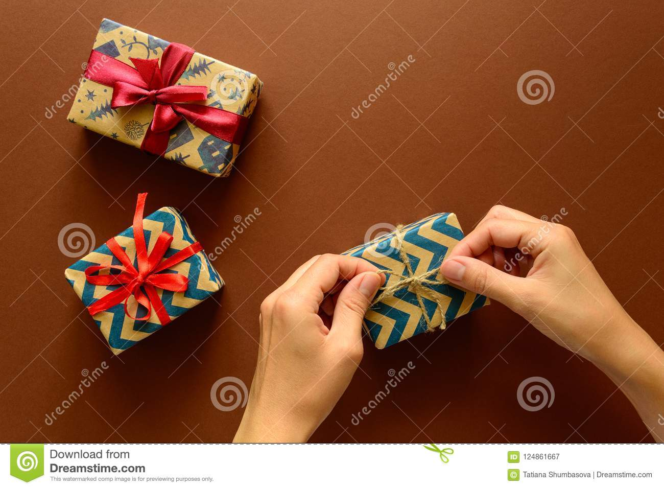 Woman`s Hands Decorate Present Box On Paper Background ...