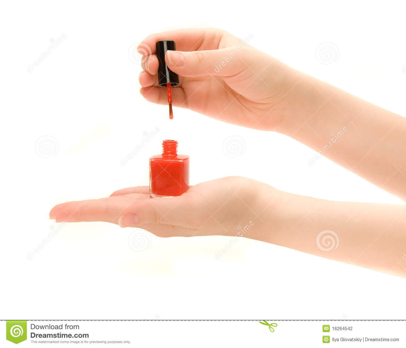 Nail Polish Colors For Younger Looking Hands: Woman's Hands Holding A Bottle Of Nail Polish Stock