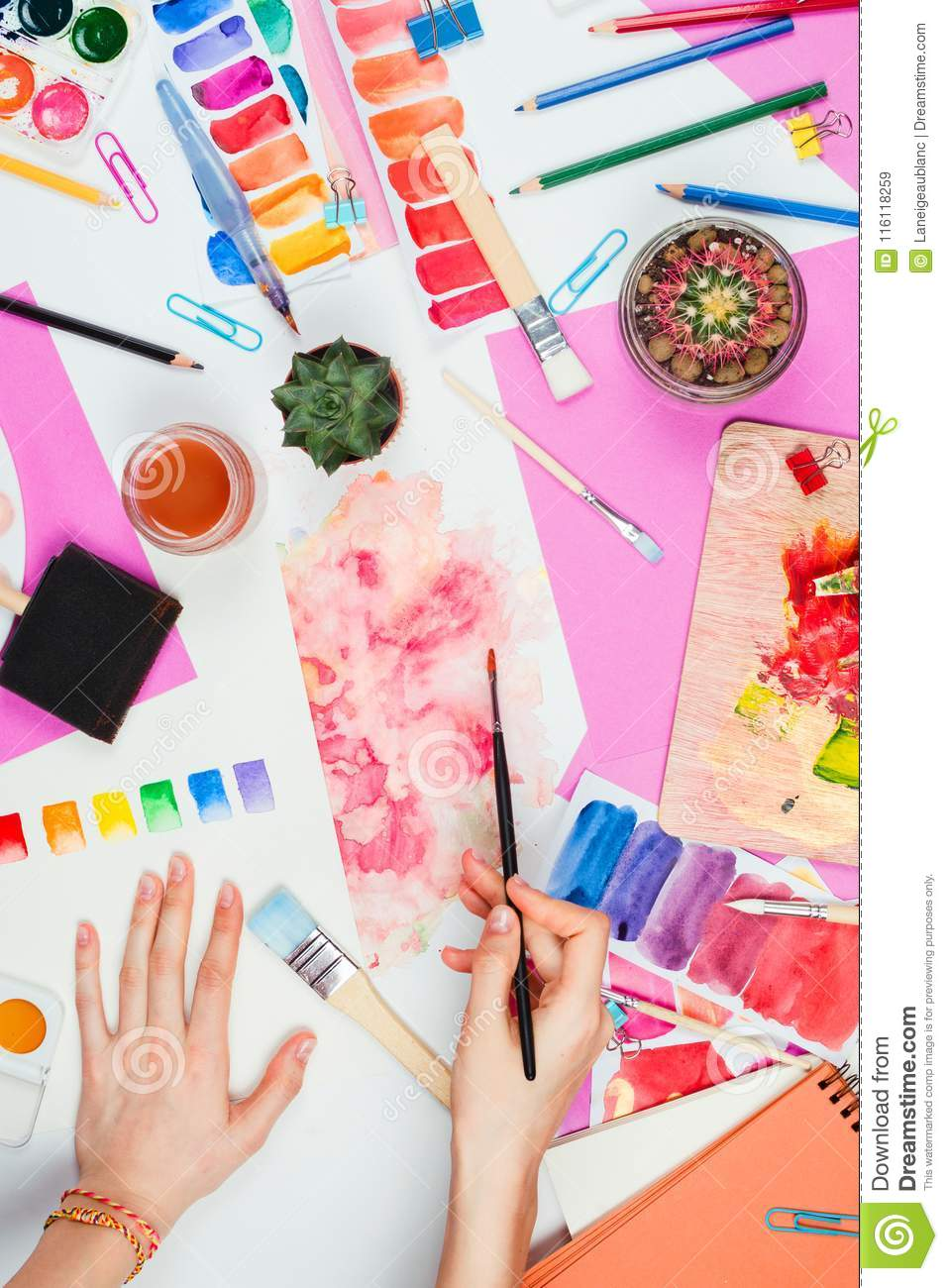 https://thumbs.dreamstime.com/z/woman-s-hands-holding-brush-pallets-pencils-watercolors-colored-paper-other-stationary-supplies-flatlay-artist-116118259.jpg