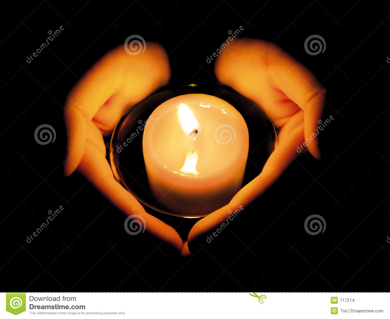 WOMAN S HANDS LIT BY A CANDLE