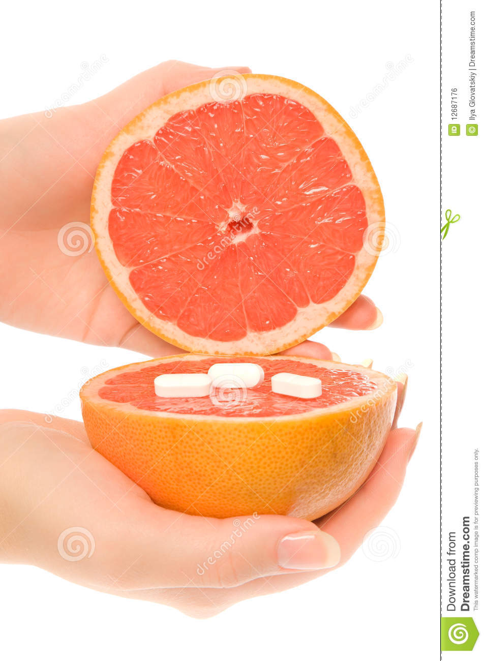 Woman s hands with two pieces of grapefruit