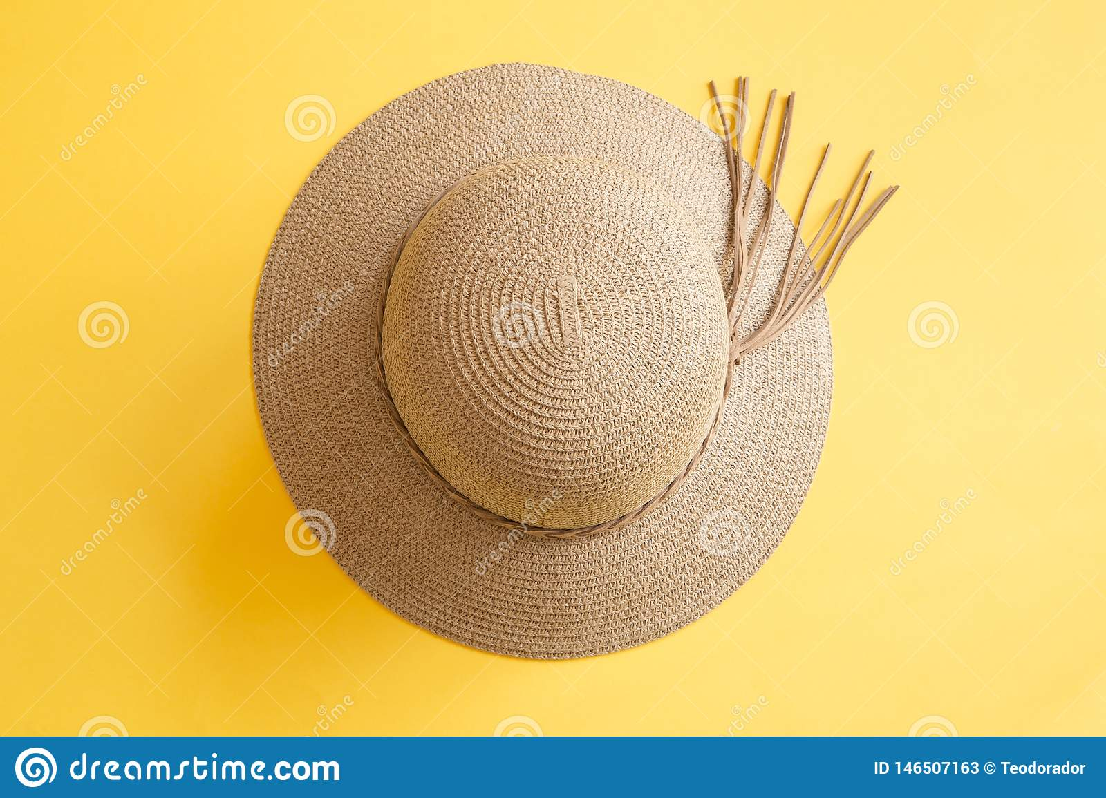 Woman`s hat on yellow background