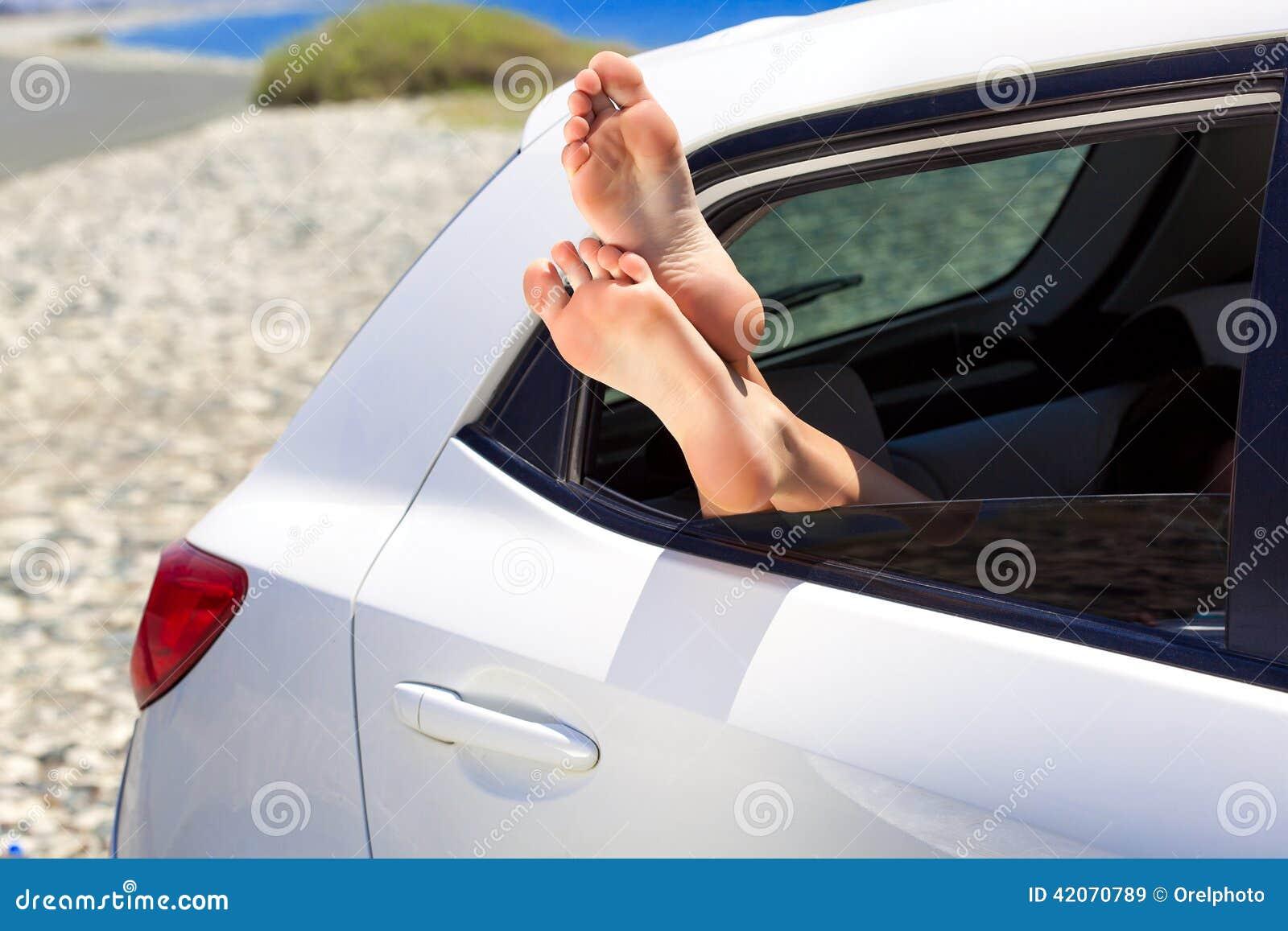 woman u0026 39 s legs dangling out a car window stock photo