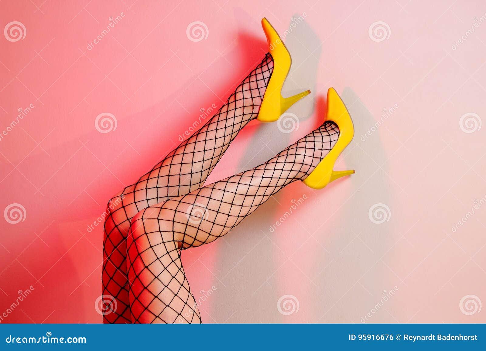 6add1828333 Woman's Legs In Fishnet Tights Stock Photo - Image of weak, fishnet ...