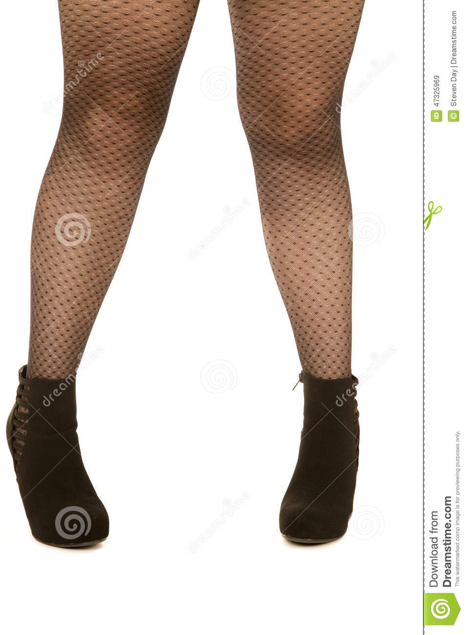 bd6831be8e21 Woman s Legs Wearing Fishnet Stockings And High Heels Stock Photo ...
