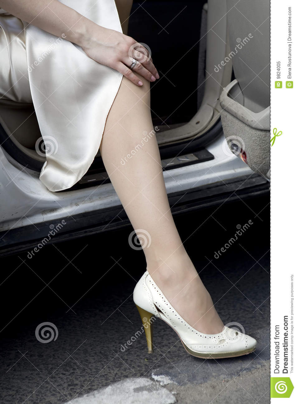 s legs wearing white shoes with heels royalty free