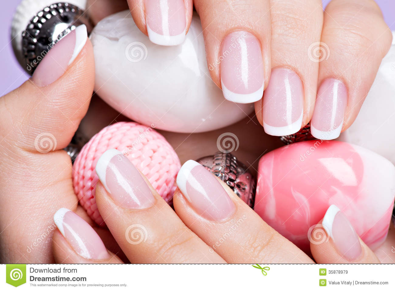 Woman s nails with beautiful french white manicure