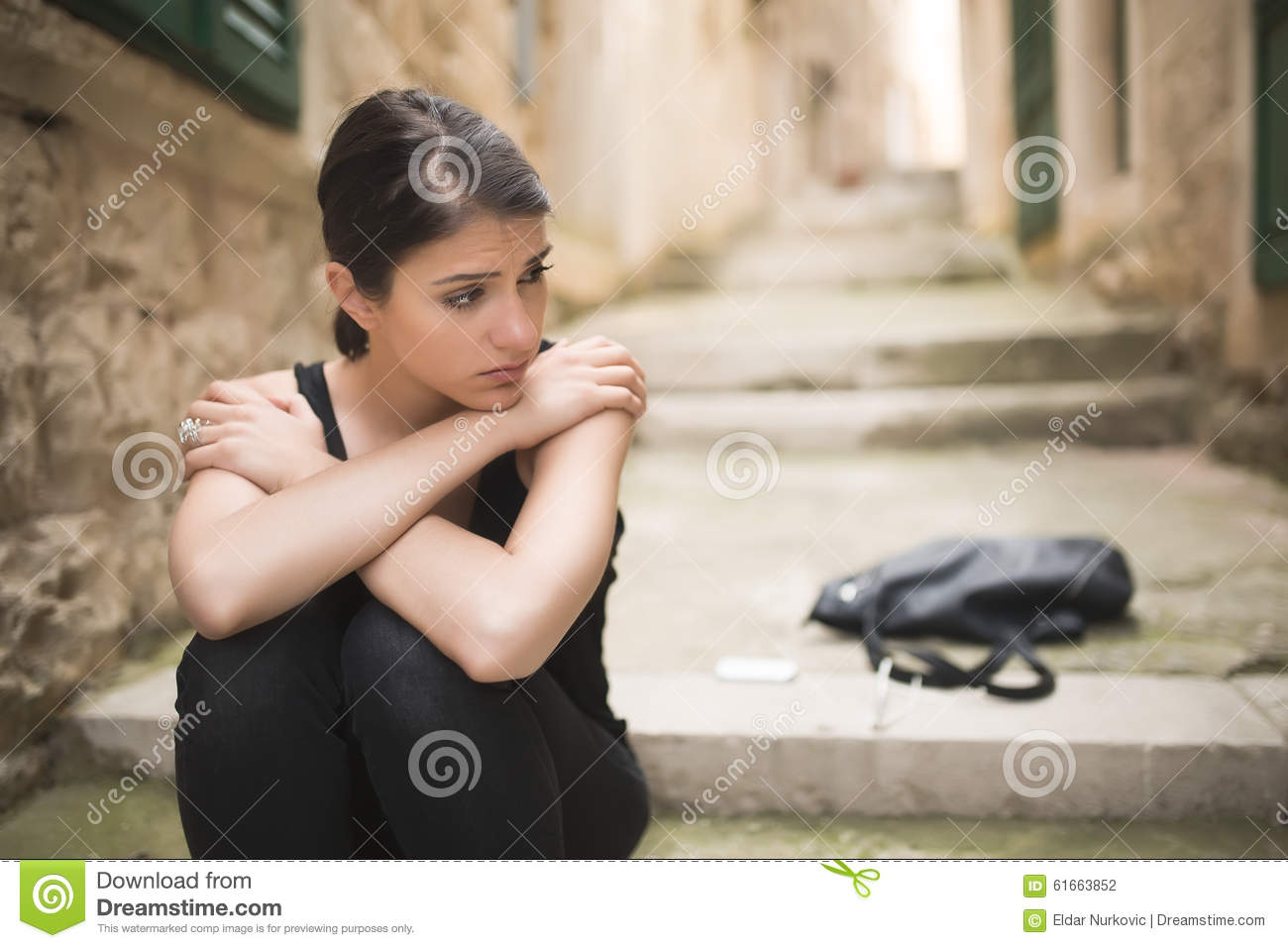 Woman with sad face crying. Sad expression, sad emotion, despair, sadness. Woman in emotional stress and pain. Woman sitting alone