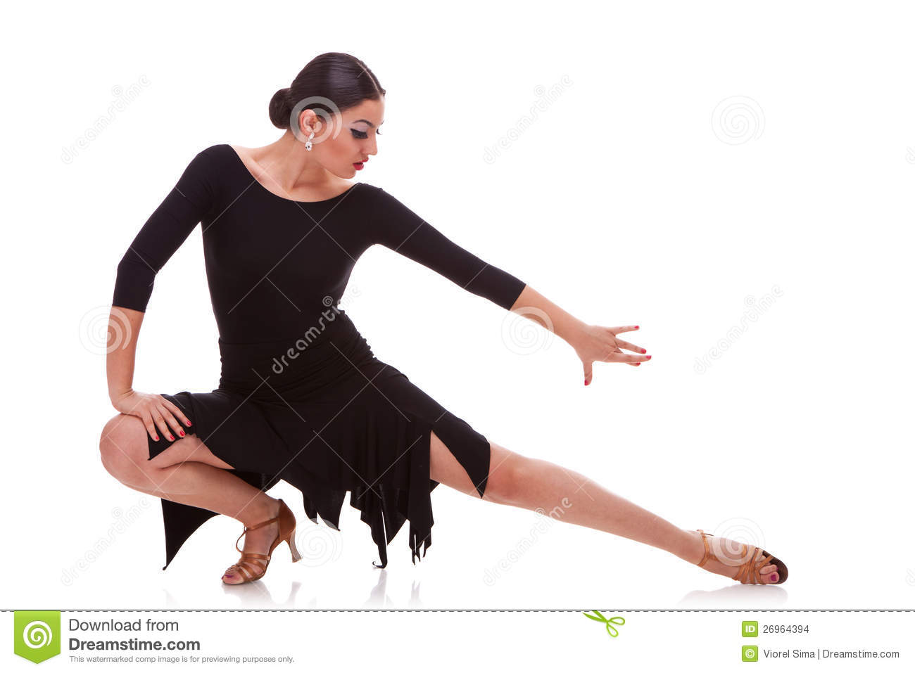 Portrait of a young woman salsa dancer in a lunge dance pose isolated