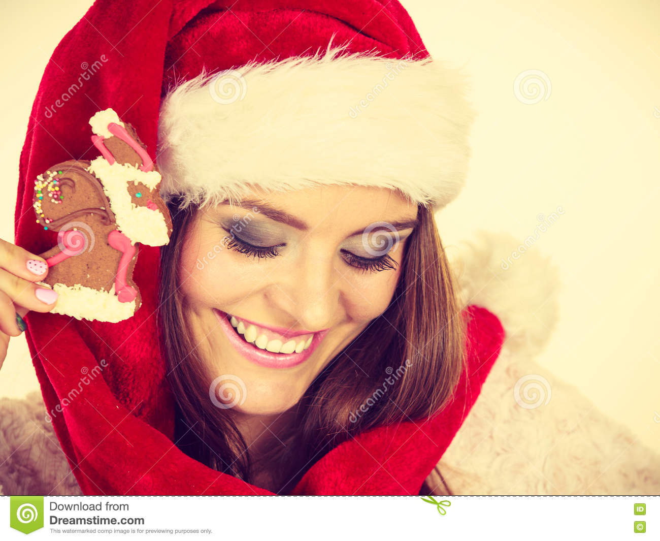ab3ef3a8f Woman Santa Claus Hat With Gingerbread Cookie. Christmas Stock Photo ...